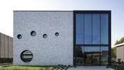 Новинка от Baumit - надёжная защита яркого фасада от осадков и грязи